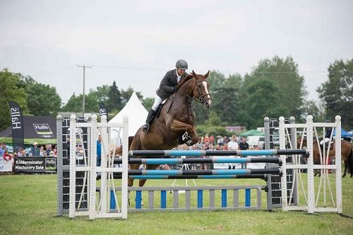 A horse rider jumping over a fence at Hanbury Show. Credit: Rachel Maddox Photography.