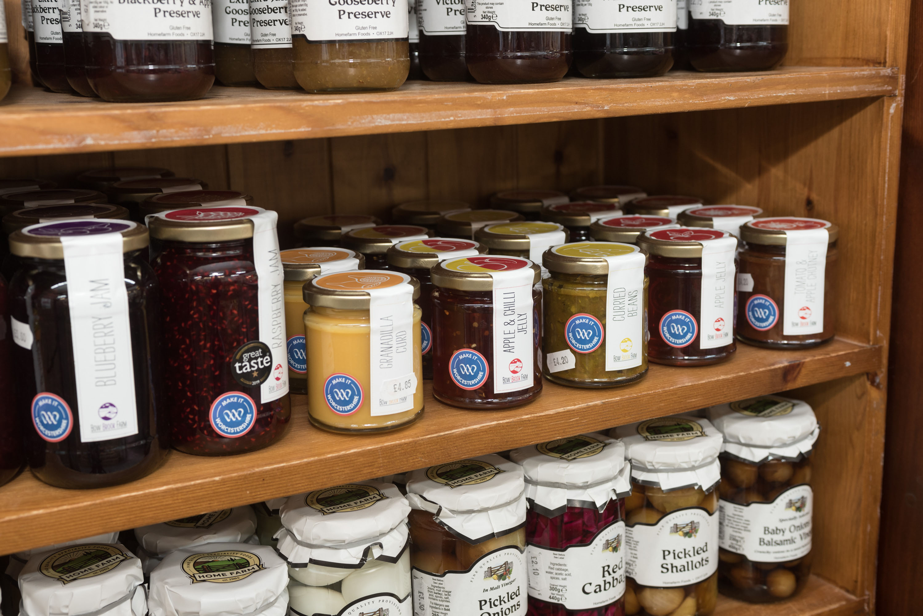 Selection of jams on a shelf branded with the Make It Worcestershire campaign sticker.
