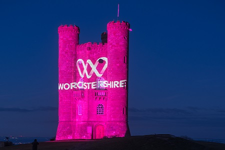 Broadway tower lit up pink